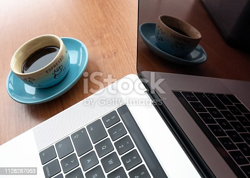 862672018 istock photo Office wood table with  laptop 1128287053
