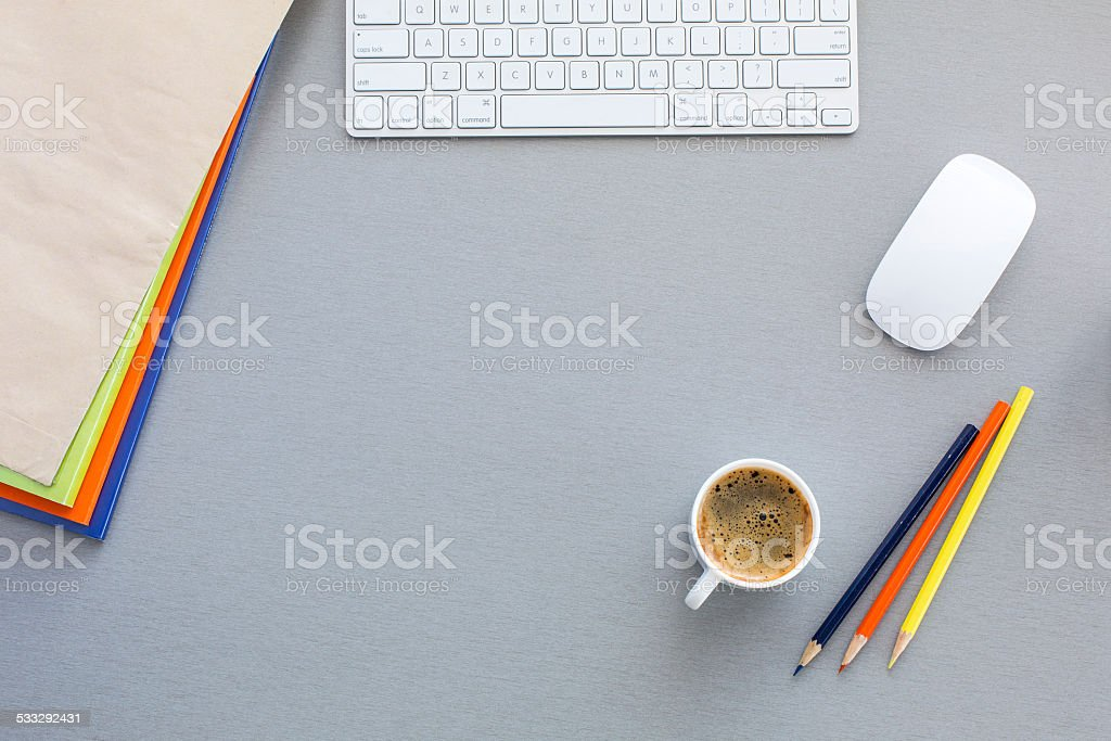 Office work space on grey wood table stock photo