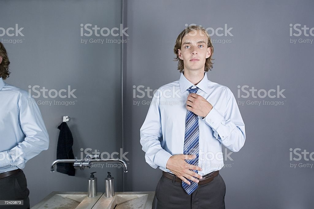 Office worker adjusting his tie royalty-free stock photo