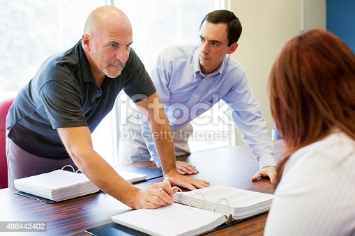 istock Office worker aggressively makes a point during meeting 486443402