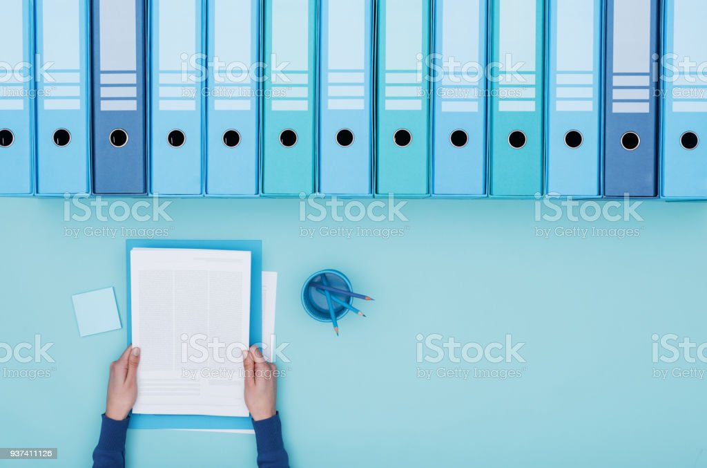 Office worker and archive binders stock photo