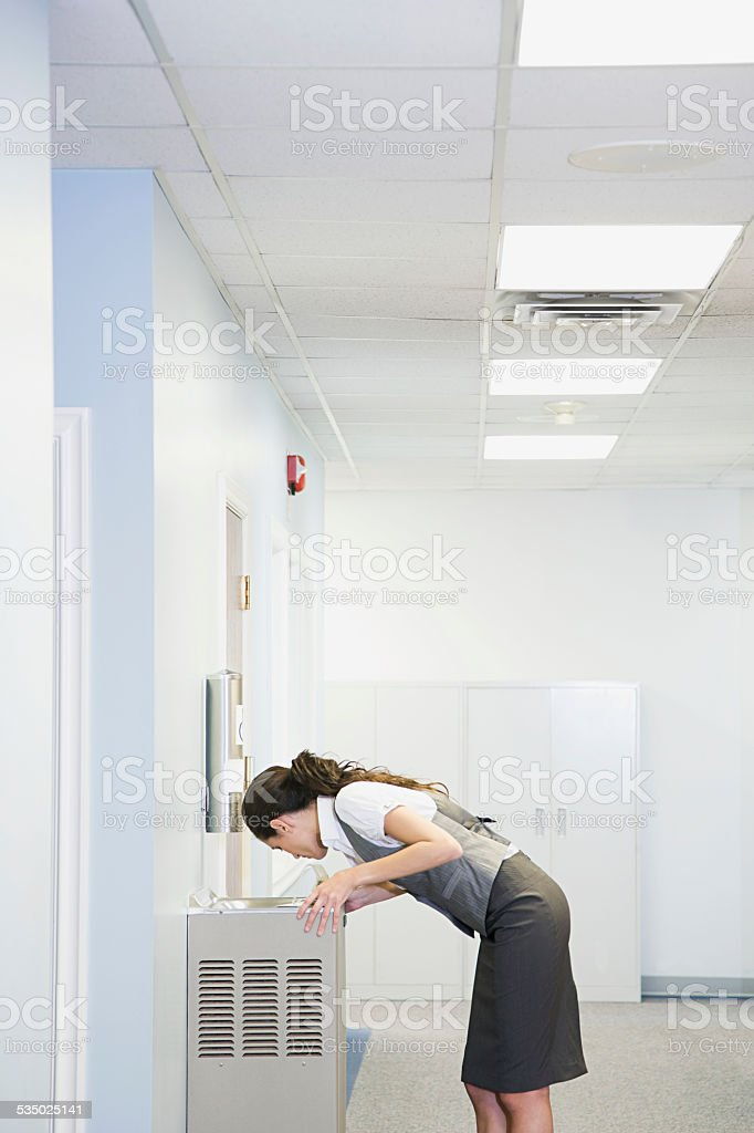Office worker at water fountain stock photo