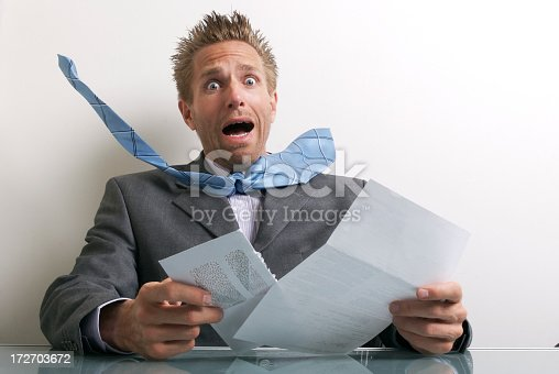 481644192 istock photo Office Worker Businessman Opening Letter with Expression of Stress 172703672