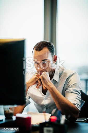 1053499704 istock photo Office Worker Concentrating At His Computer 1053499586