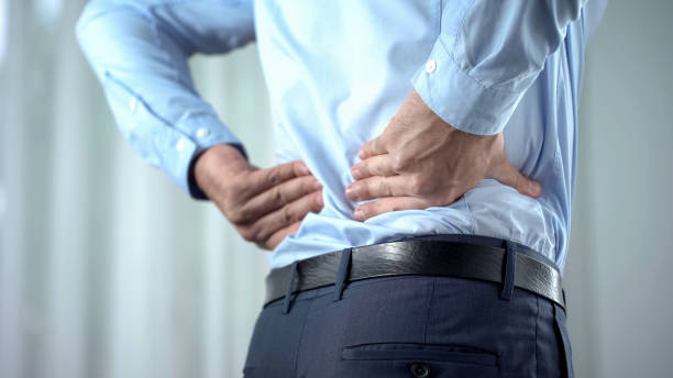 Office worker feeling sharp back pain, sedentary lifestyle, slipped disc Office worker feeling sharp back pain, sedentary lifestyle, slipped disc back pain stock pictures, royalty-free photos & images
