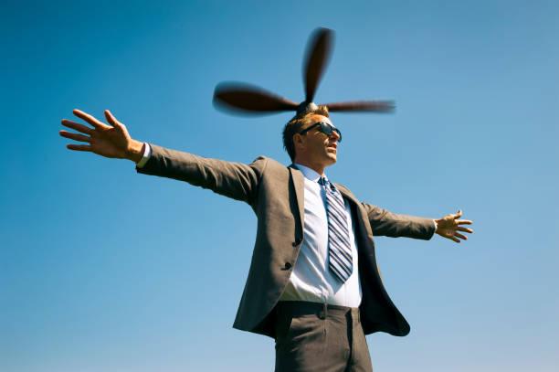 Office Worker Flying in Blue Sky stock photo