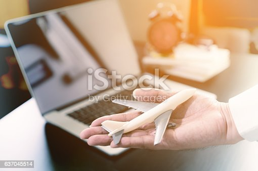 istock Office worker hand holding a plan business travel concepts. 637045514