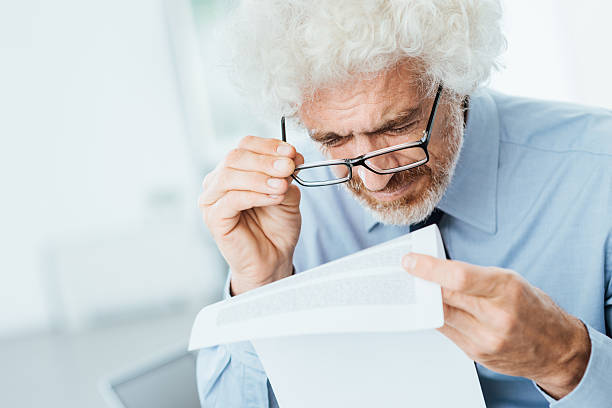 Office worker having eyesight problems stock photo