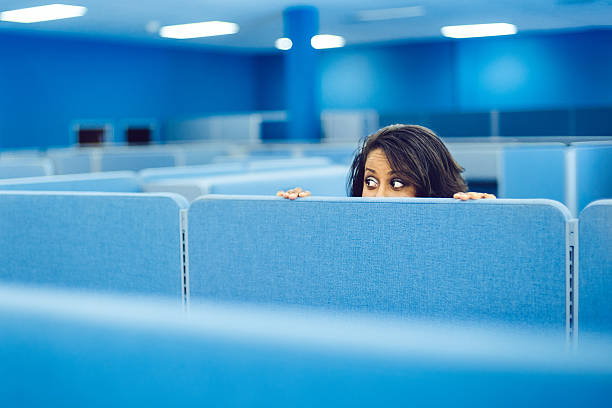 office worker hiding - female spy stock photos and pictures