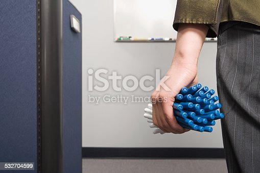istock Office worker holding lots of pens 532704599