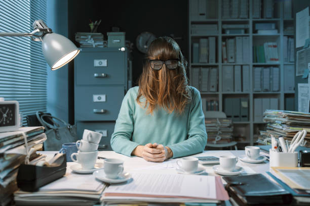 Office worker insane from overwork stock photo