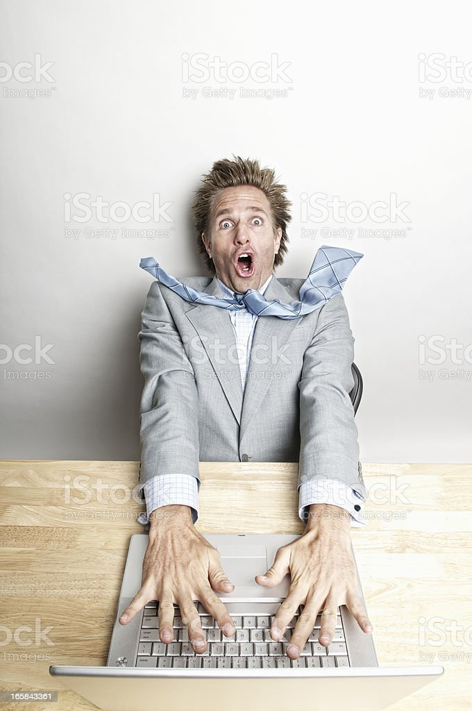 Office Worker Is Blown Away By Laptop Computer royalty-free stock photo