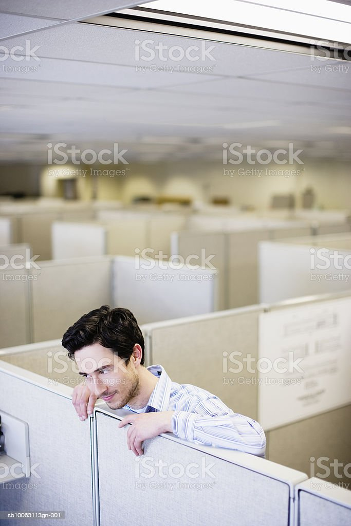 Office worker leaning on partition royalty-free stock photo