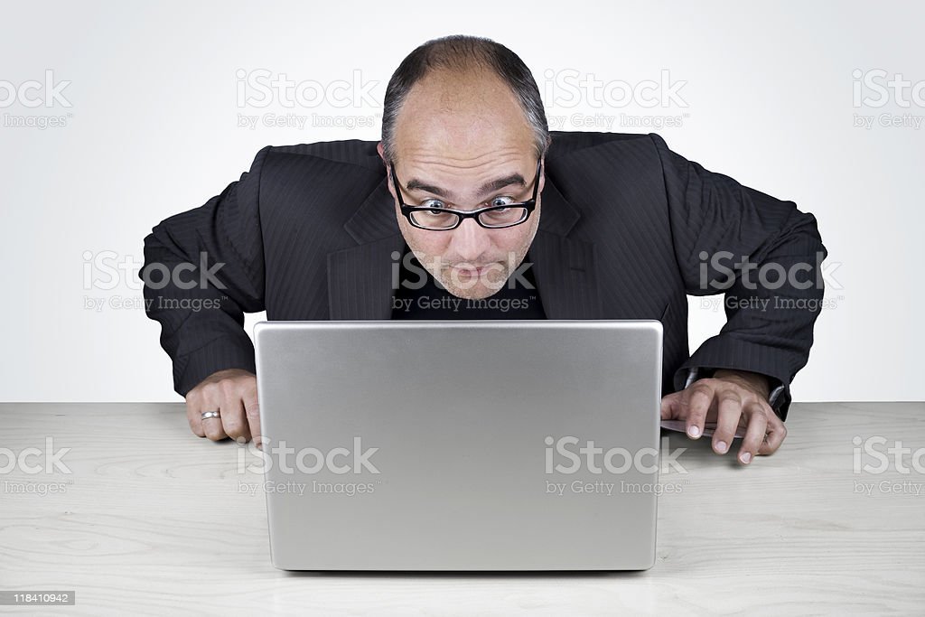 WTF? - Office worker looking very surprised at his laptop royalty-free stock photo