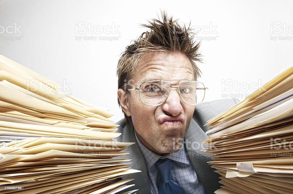 Office Worker Looks Fed Up with Paperwork stock photo