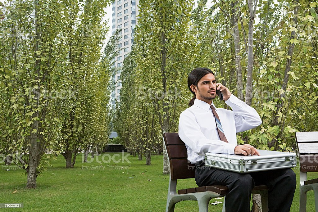 Office worker making a telephone call 免版稅 stock photo