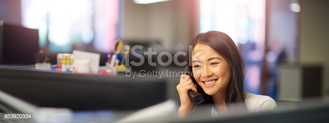 istock office worker on the phone 853920334