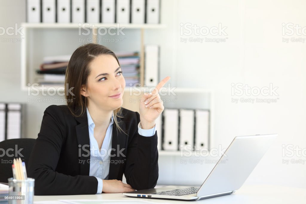 Office worker pointing at side to a blank space royalty-free stock photo