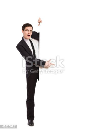 istock Office worker pointing at white banner. 462250721
