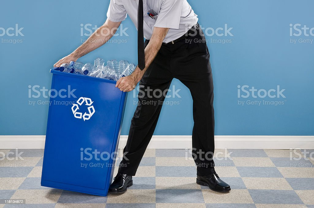 Office Worker Recycling Plastic Bottles. royalty-free stock photo