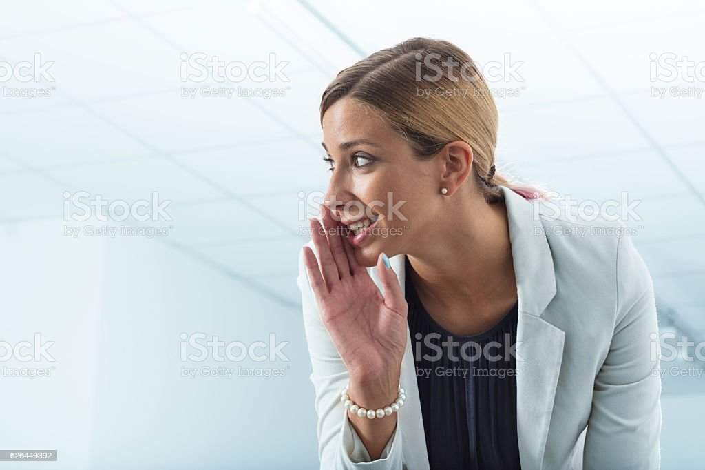 office worker revealing secrets stock photo