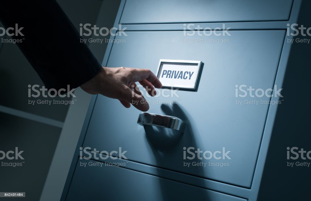 Office worker searching confidential information stock photo