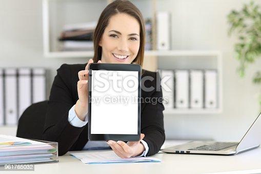 863476166istockphoto Office worker showing a tablet screen mockup 961765032