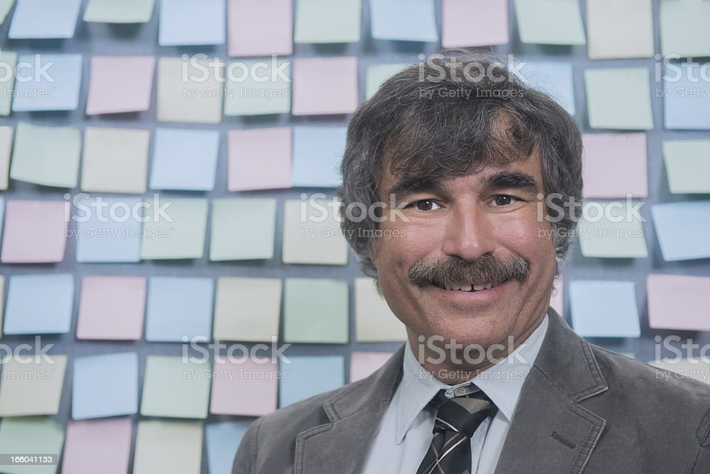 Office Worker Surrounded by Reminders royalty-free stock photo