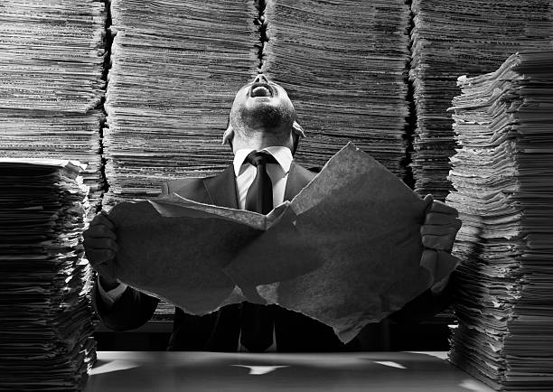 office worker tearing up papers and screaming out - paper mass bildbanksfoton och bilder