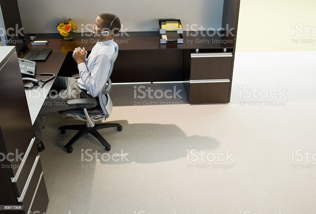 office worker using phone headset royalty free stockfoto