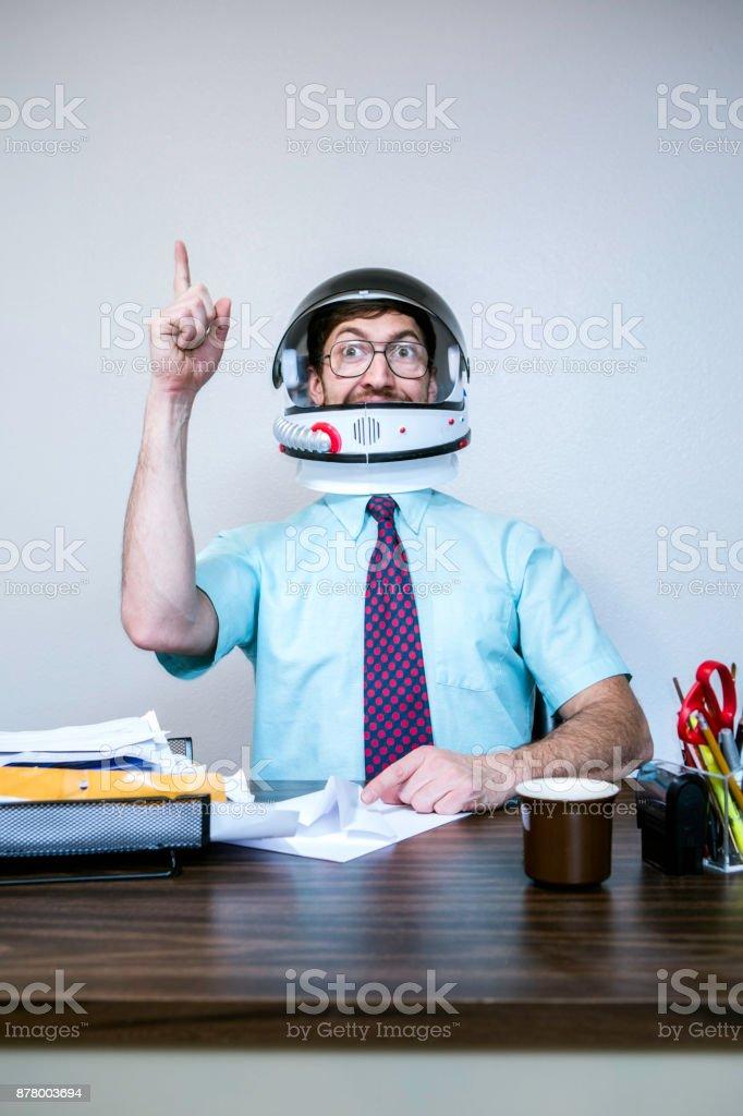 Office Worker Wearing Astronaut Space Helmet stock photo