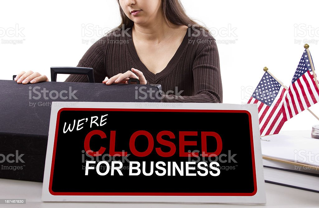 Office Worker with a Closed Sign Because of Goverment Shutdown - Royalty-free Adult Stock Photo