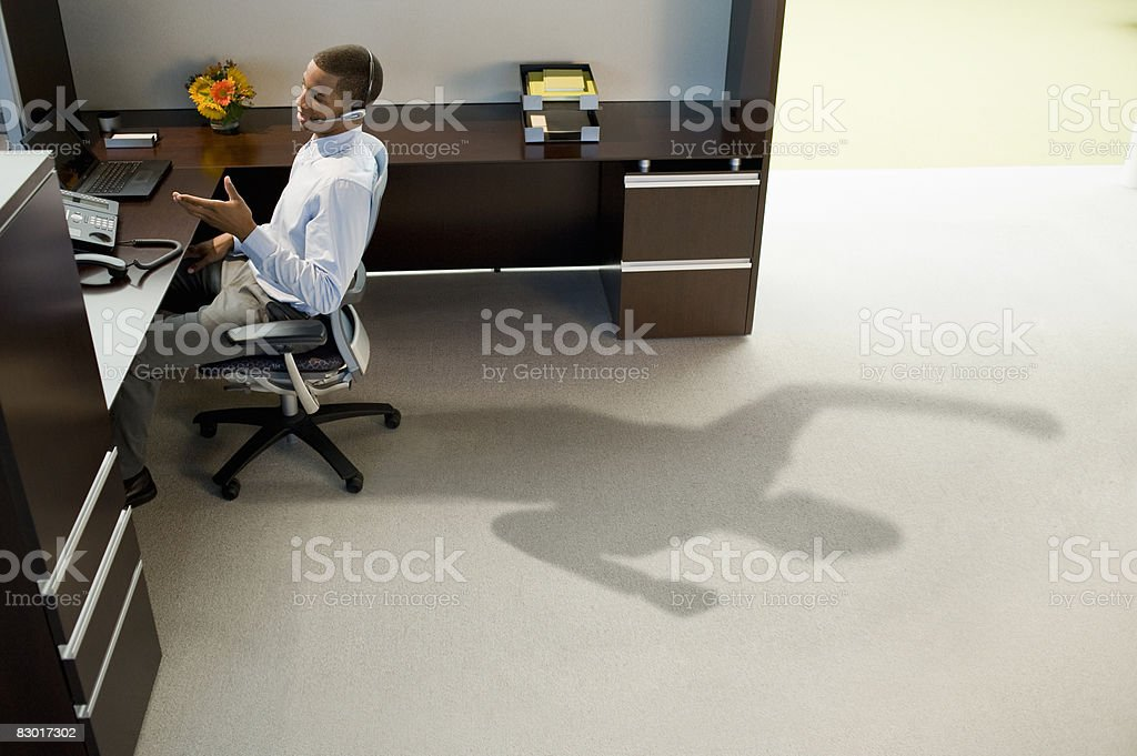 office worker with revealing shadow royaltyfri bildbanksbilder