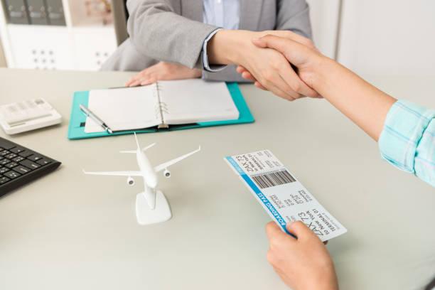 office worker with traveler customer handshake stock photo