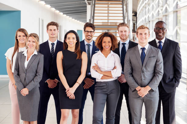 Office workers in a modern lobby, group portrait stock photo