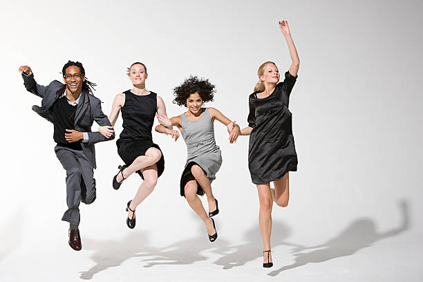 Office workers jumping stock photo