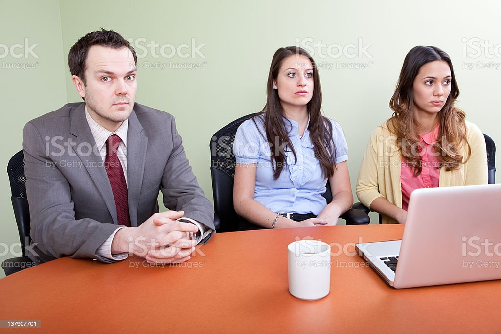 Office workers seems sad during an office meeting stock photo