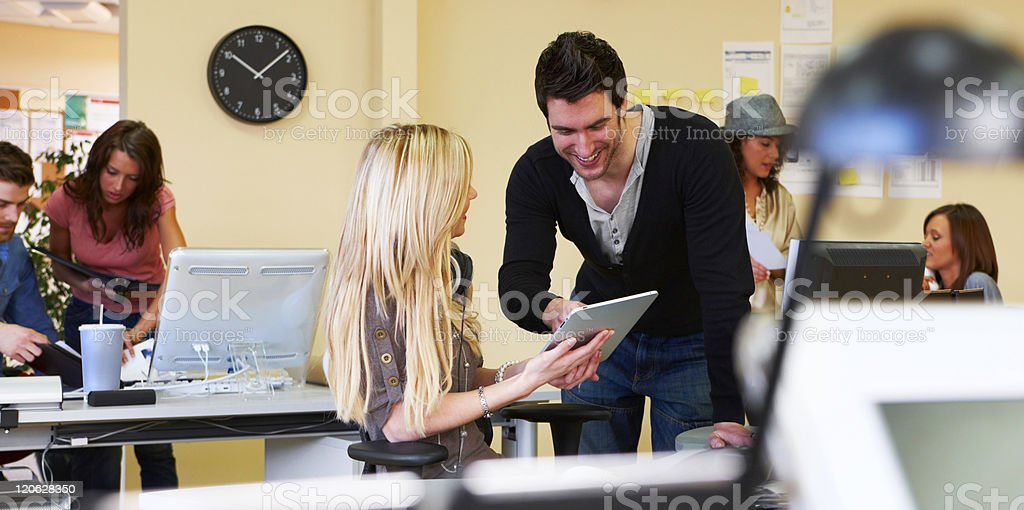 Office Workers Using a touch pad stock photo