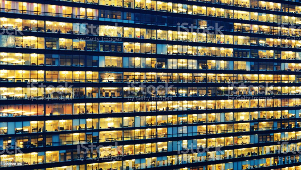Office workers working late in major office building stock photo