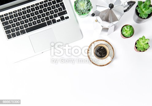 istock Office workplace Flat lay Coffee laptop succulents 666675390