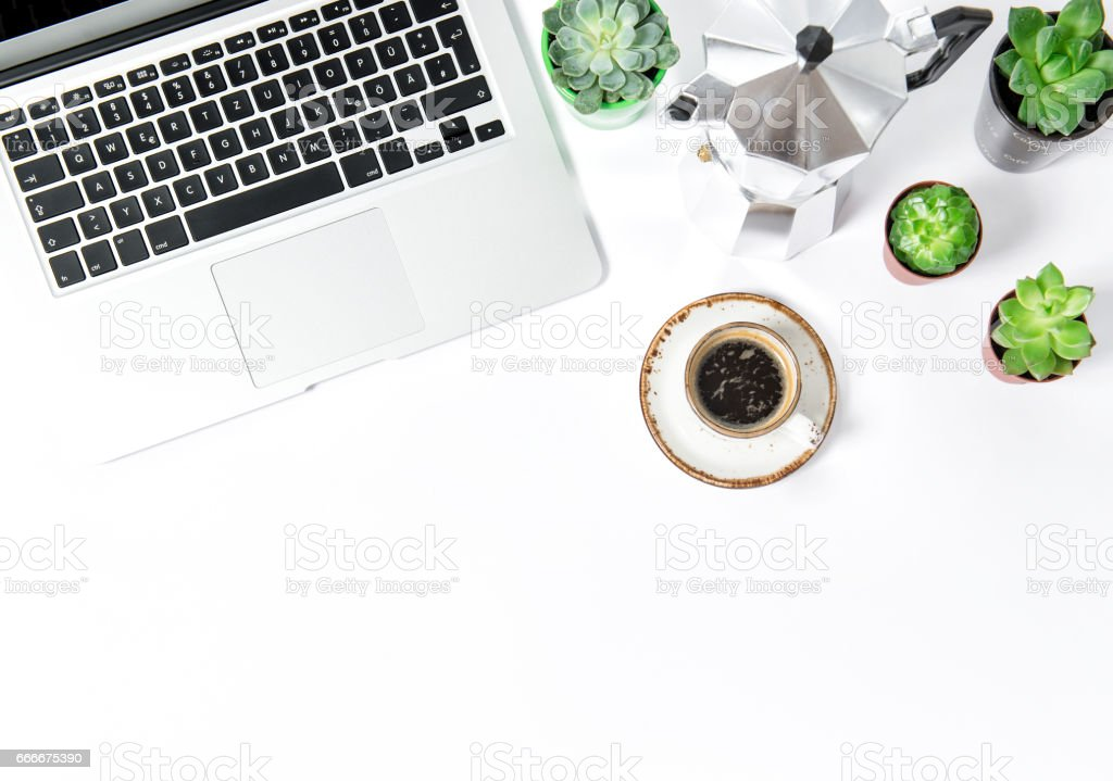 Office workplace Flat lay Coffee laptop succulents stock photo