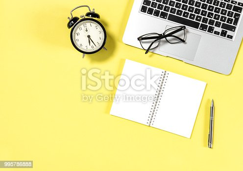 istock Office workplace minimal flat lay Laptop notebook 995786888