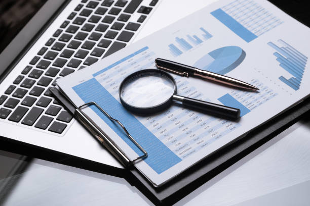 Office workplace with magnifier and stationery stock photo