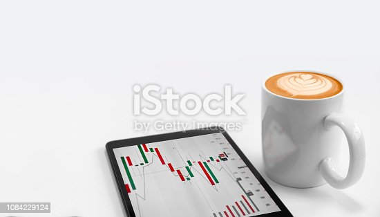 istock Office workplace with tablet and coffee cappuccino froth art with copy space. 1084229124