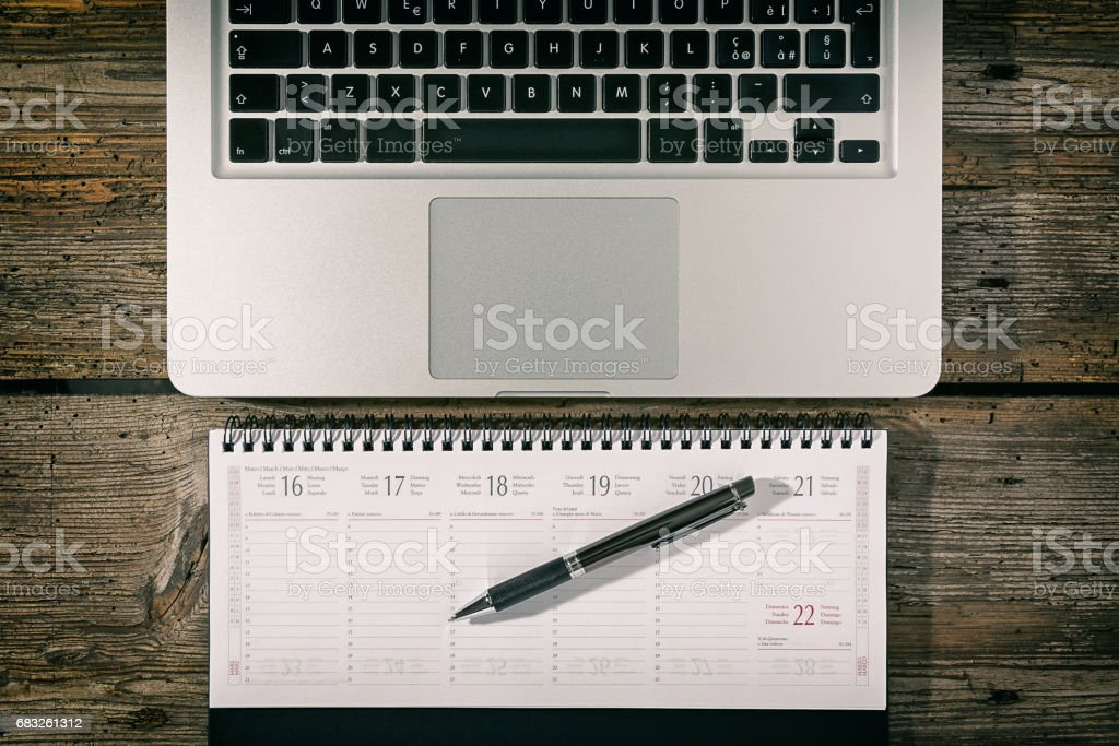 Office workstation with laptop, agenda and pen foto de stock royalty-free