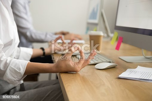 istock Office yoga for relaxation concept, female hands in mudra, closeup 926375604