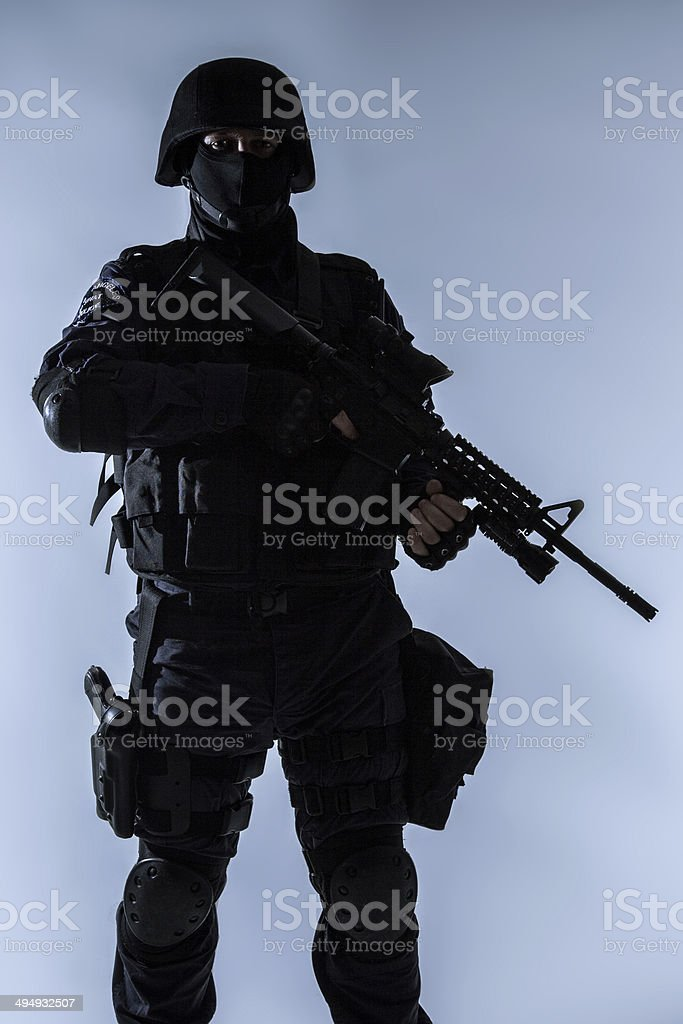 SWAT officer backlit royalty-free stock photo