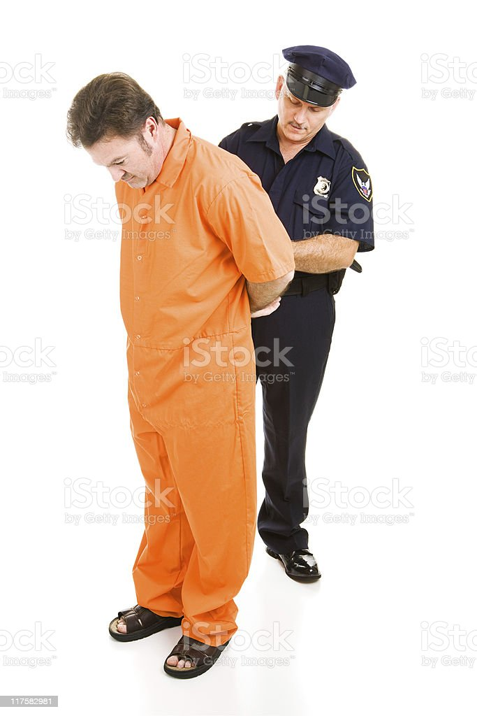 Officer Handcuffs Prisoner stock photo