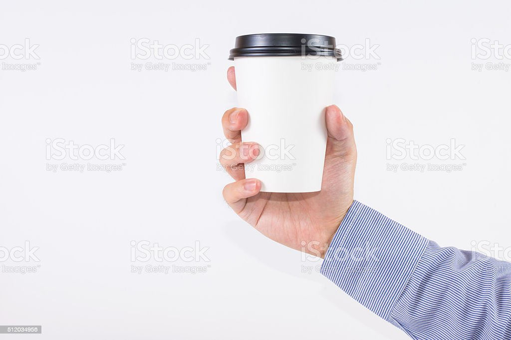 Officer handle a white coffee cup stock photo
