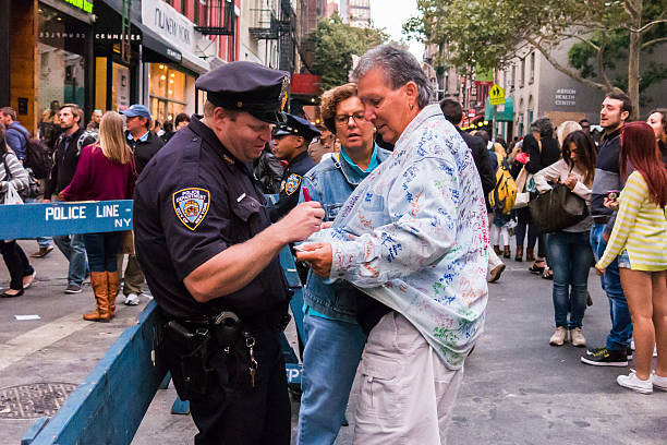NYPD officer has fun with tourists at San Gennaro stock photo